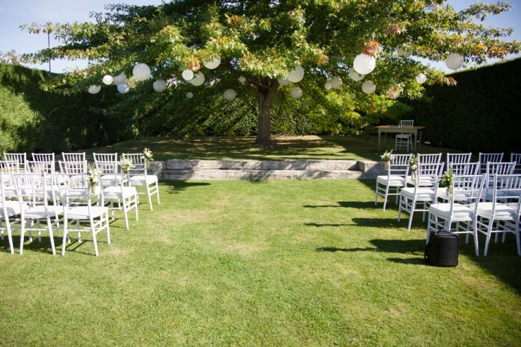 Garden wedding ceremony. Love the lanterns hanging in the tree ...