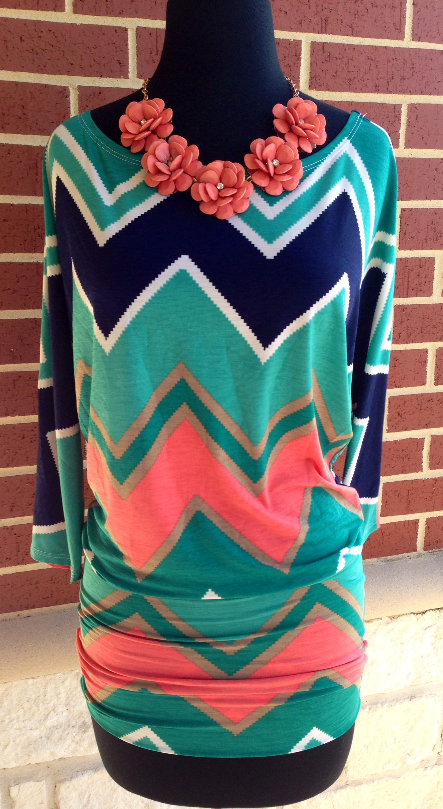 The color combo is just FAB on this super cute top! Looks great with white bottoms now and then pair it with dark skinnys and boots this fall! Sz: S-L $36
