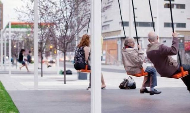 An artist decided to install swings at a bus stop making waiting much more fun.