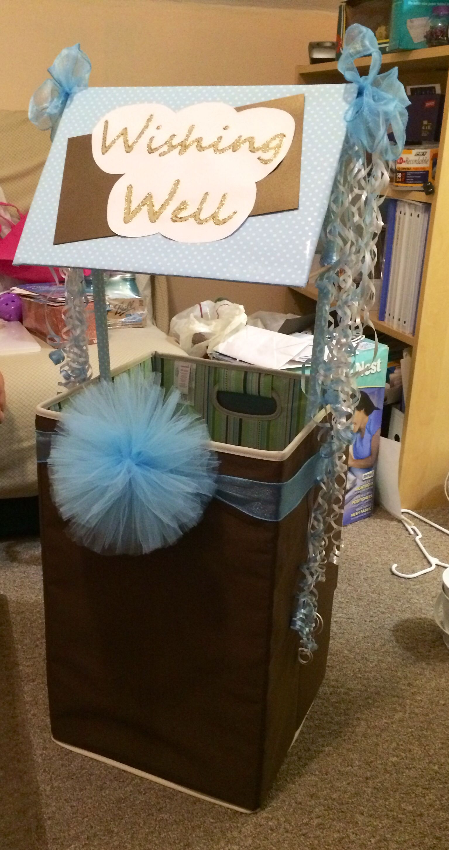 Baby shower wishing well made with hamper