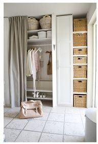 clever wardrobe storage idea - very DIY with open shelves with baskets  curtain instead of cabinetry