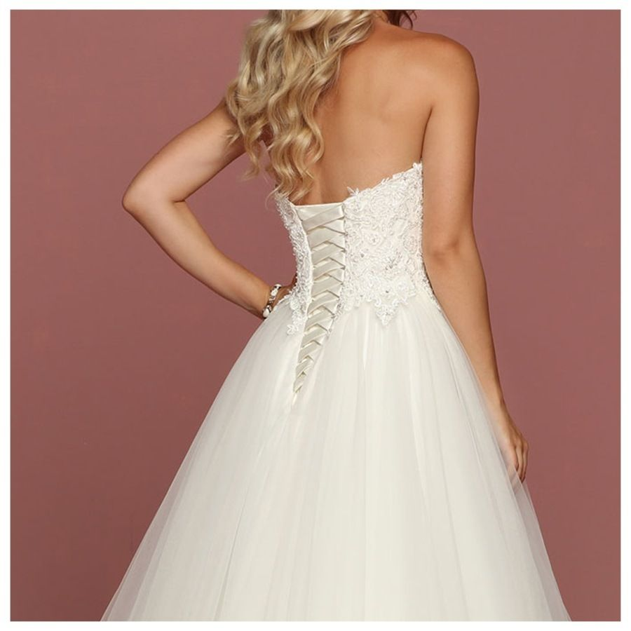 The alluring bodice in this wedding gown has a stunning laceup