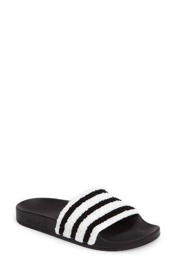 b692ff7ddab Free shipping and returns on adidas Adilette Slide Sandal (Women) at  Nordstrom.com. Get in on this season s athleisure trend with this slide  sandal ...