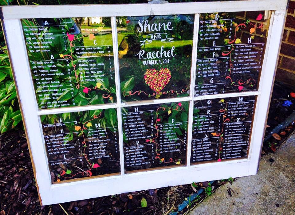 Custom, hand painted wedding window seating charts Our Wedding