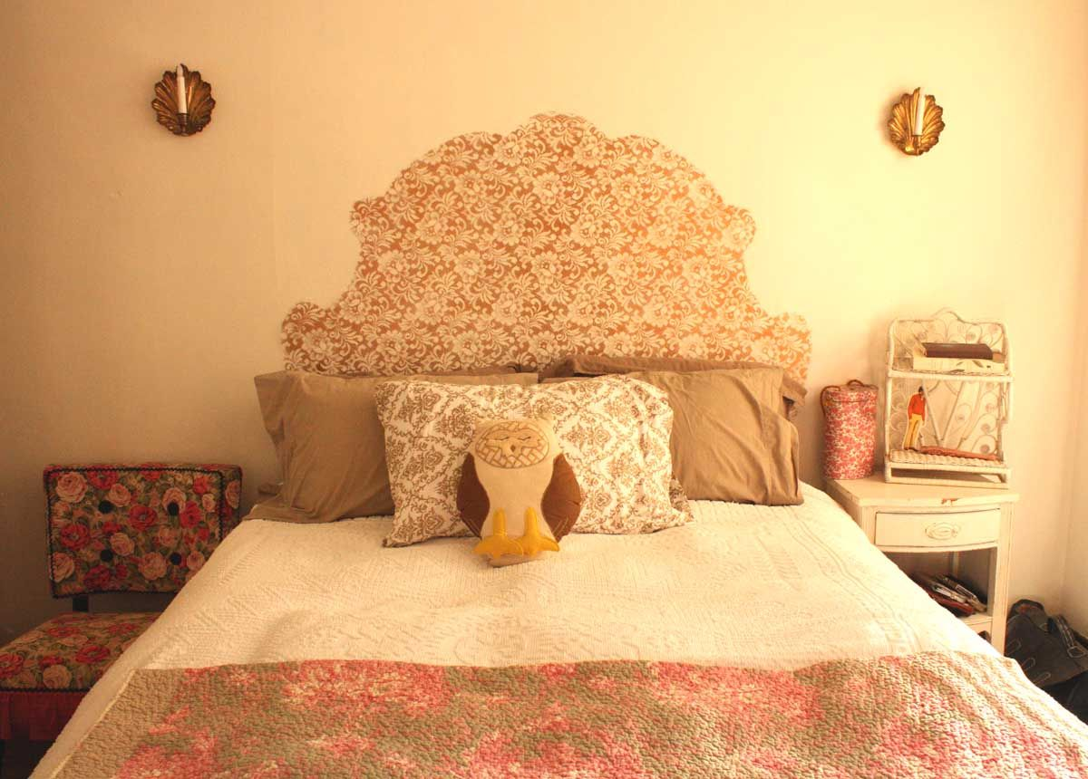 You make this by creating a headboard stencil, laying lace down ...