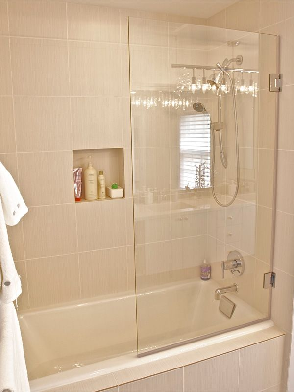 Frameless Hinged Glass enclosure for tub...idea for downstairs ...