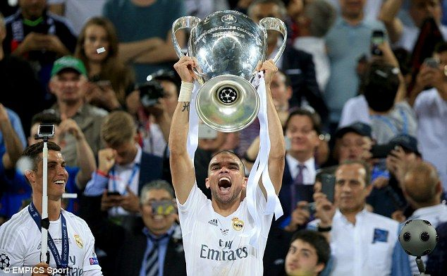 Pepe lifts the Champions League trophy after helping Real Madrid beat Atletico on penalties int he final