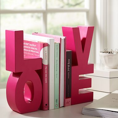 Why didn't I think of this? I've been looking for book ends forever. Wood or paper mâché letters from the craft store glued together, and then painted. You could make this into virtually any word! So doing this.