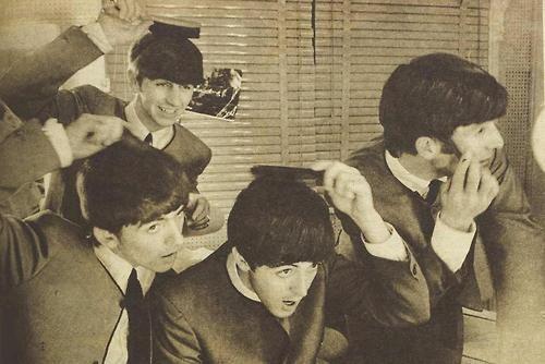 Richard Starkey, George Harrison, Paul McCartney, and John Lennon (The Beatles 1964 brushing their mops)