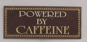 Powered by Caffeine Tin Sign, by Youngs, Inc. Measures 5 x 12 inches. Made of tin.