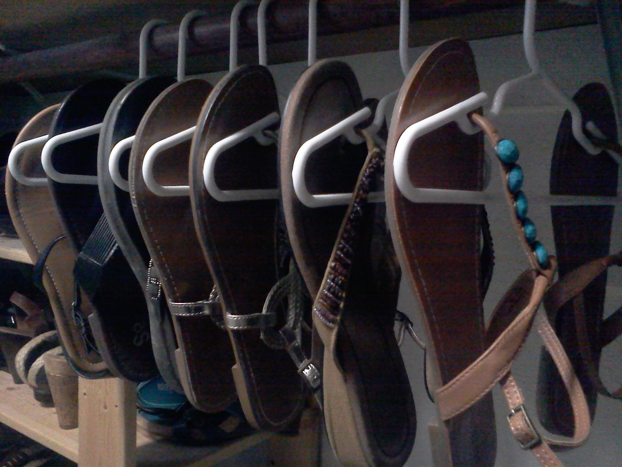 I saw a post for flip flop hangers where you had to cut and bend a wire hanger. I tried it, and it was too much work. Child size hangers, pack of 10 for just over a dollar, much easier!