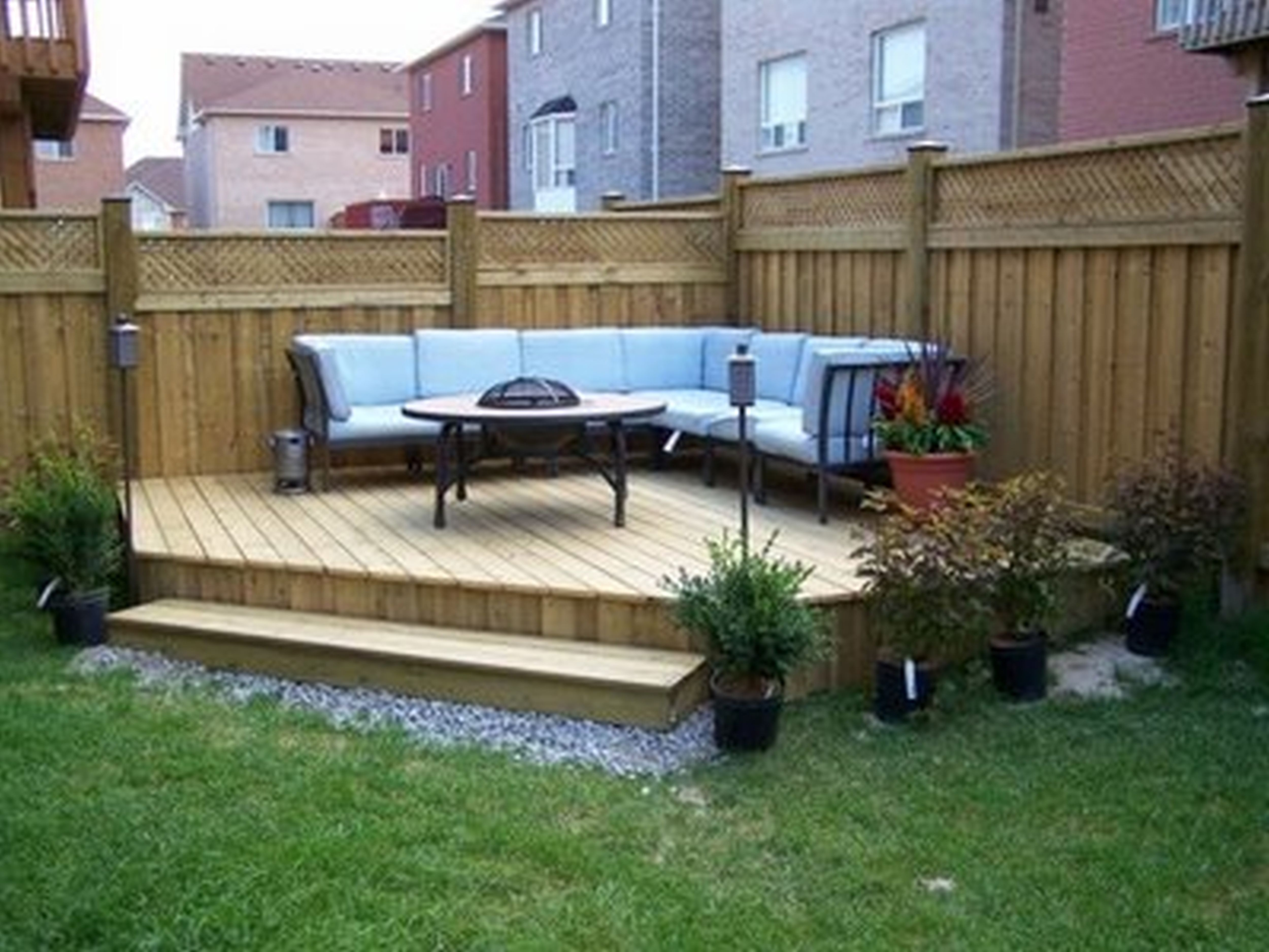 Idea for deck coming from the back door; anchor it to the ... on Deck And Patio Ideas For Small Backyards id=45516