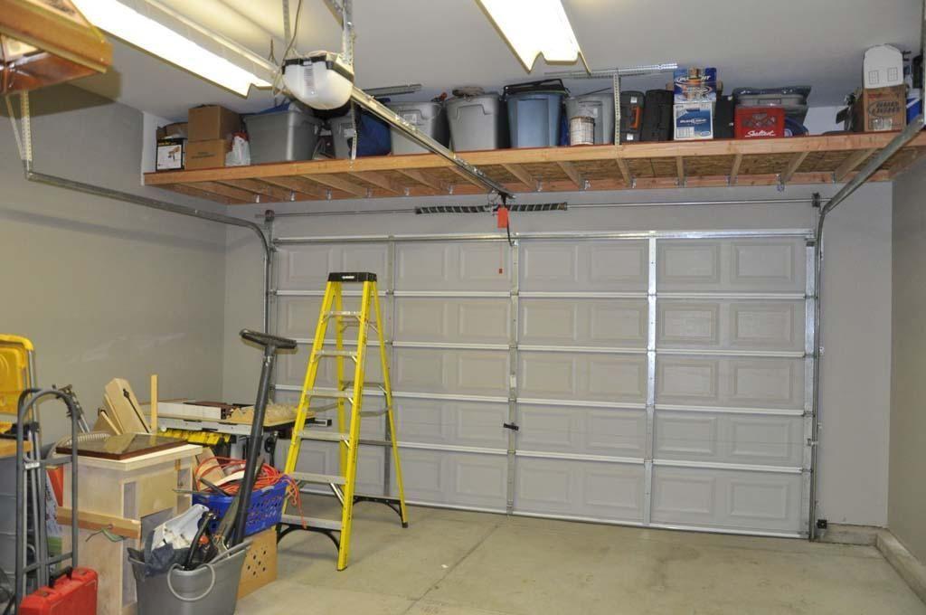 Above Garage Door Storage Project Diy Finished Garage Storage