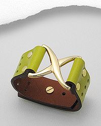leather bracelet decorated with white base metal