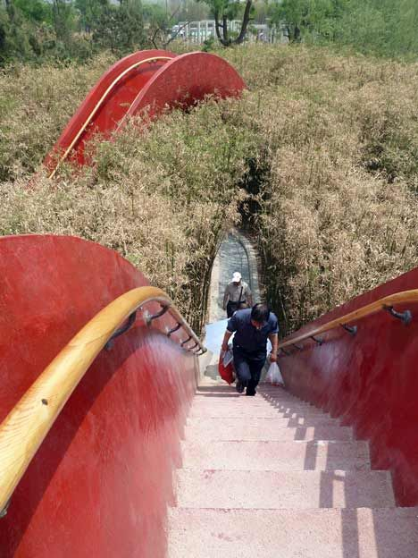 This park in Xi'an, China, by international architects West 8 recently opened to the public and contains red bridges offering vantage points.