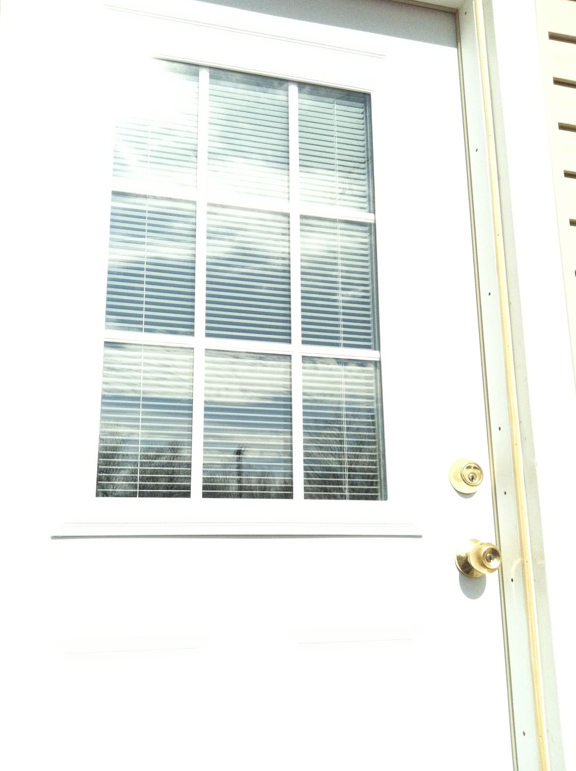 My back door finally up with but in blinds yay my stuff