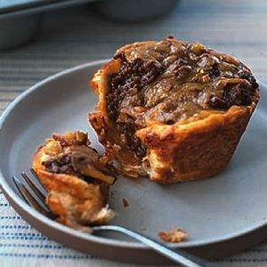 Try these Barbecue Beef Cups as an alternative to the classic chicken pot pie.  If you use a 12 muffin pan split the biscuits in half so you get more meat in each. I went and bought a 6 large muffin pan for next.