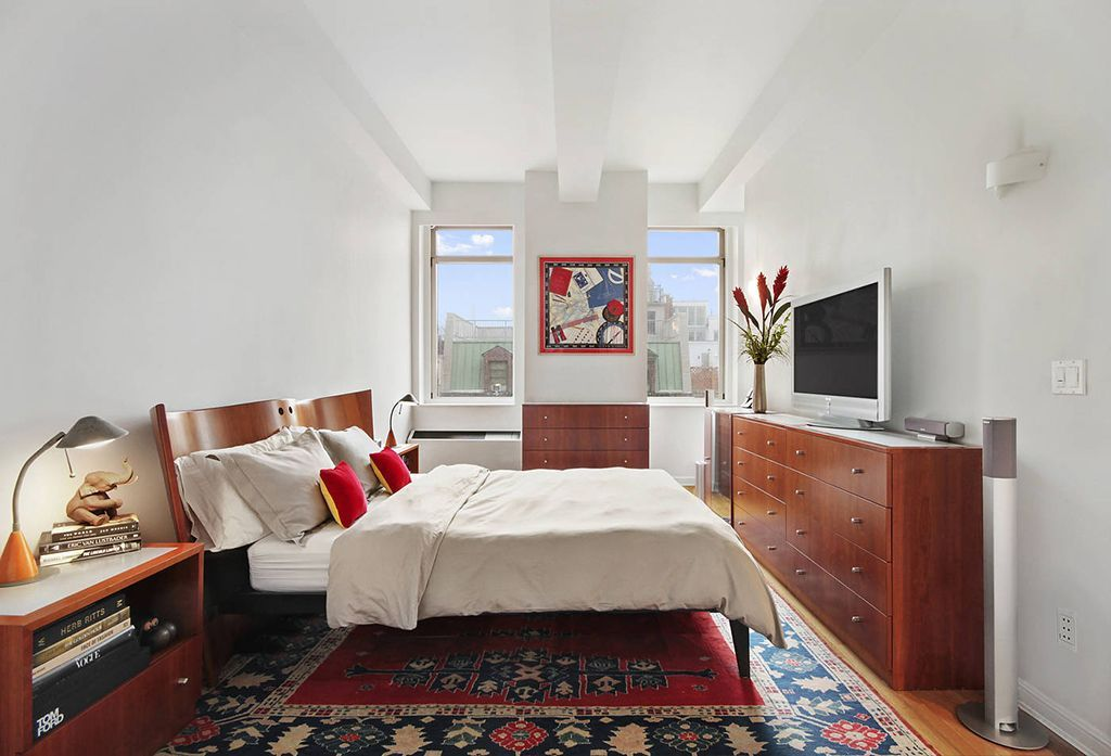 Modern Master Bedroom with Carpet by The