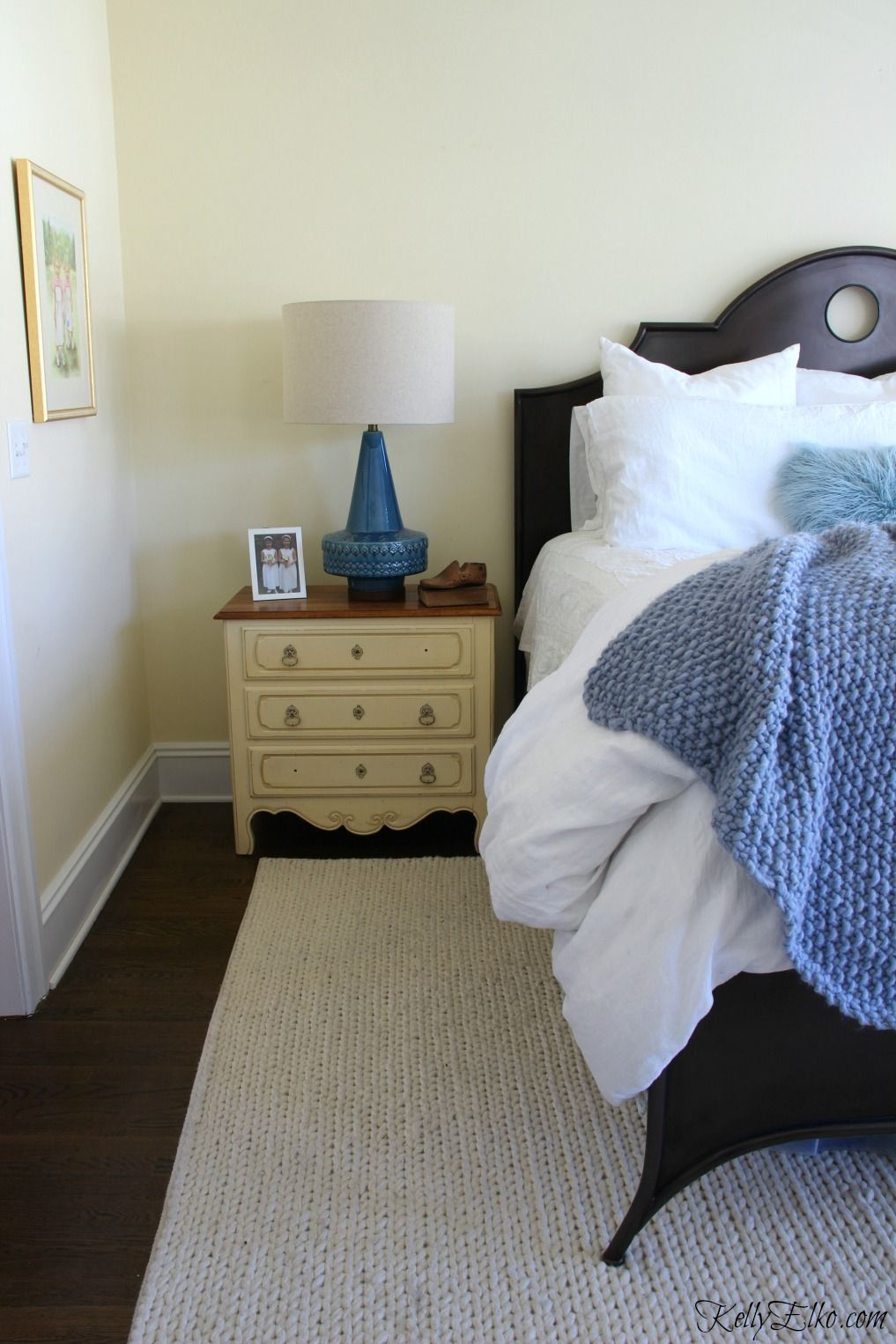 Love this neutral bedroom with blue accents