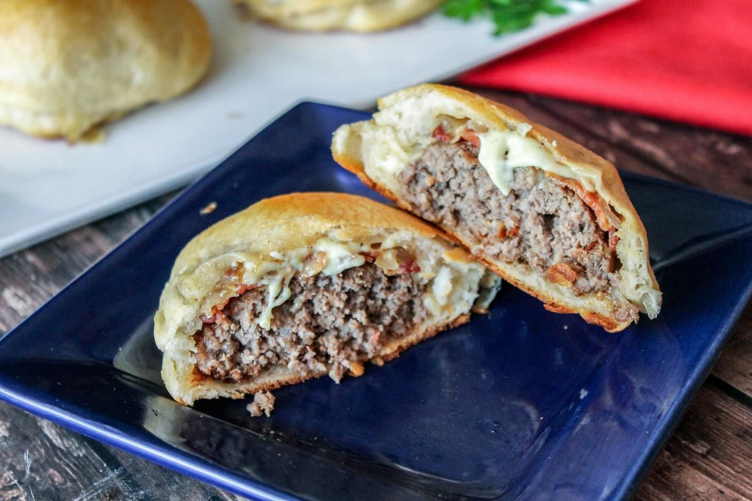 Flaky Grand Biscuits Molded Around Juicy Ground Beef And Cheese And Tender Onion And Garlic For An Extra Zip For Your Taste Buds Recipes Food Cooking Recipes