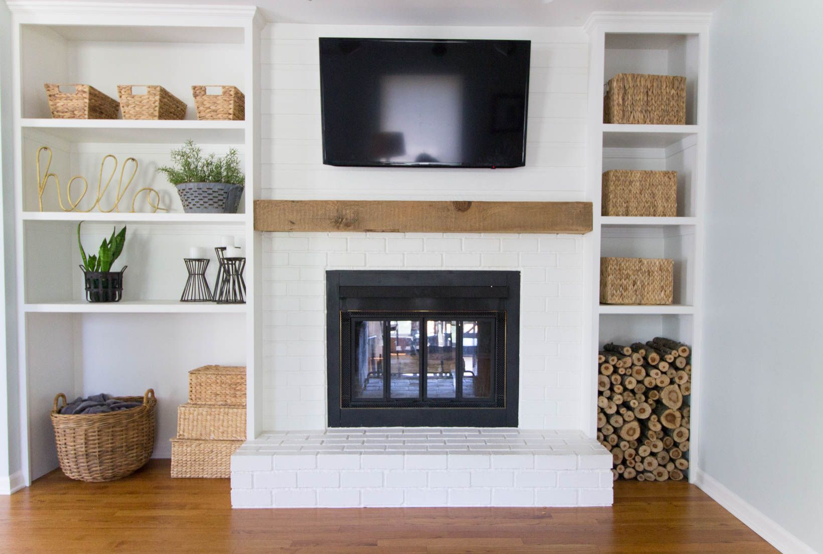 Built in shelves around shallow depth brick fireplace home sweet