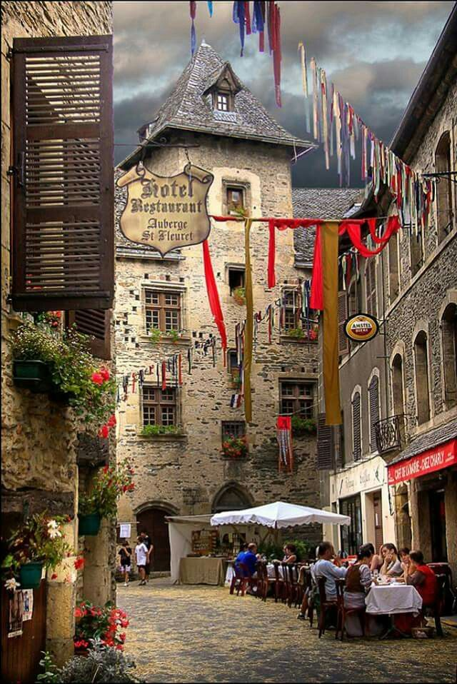 Not even a dark cloud & the threat of a storm can inhibit the practice of French café terrace lifestyle!  At Estaing, a medieval town in the Aveyron area...