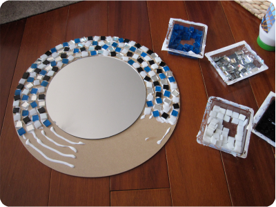 DIY Mosaic mirror | Cheap Project that's super easy to make. With a bunch of different color schemes & tiles of your choice, this type of mirror could go in almost any room. | #crafts #michaels #hobbylobby
