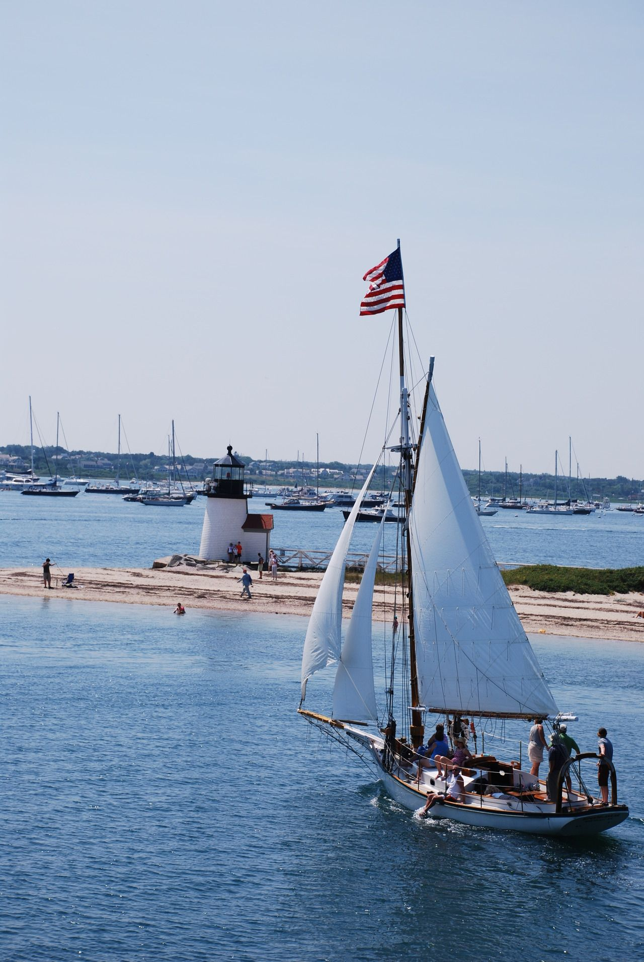 Old Glory waves in the breeze atop a sailboat in Nantucket