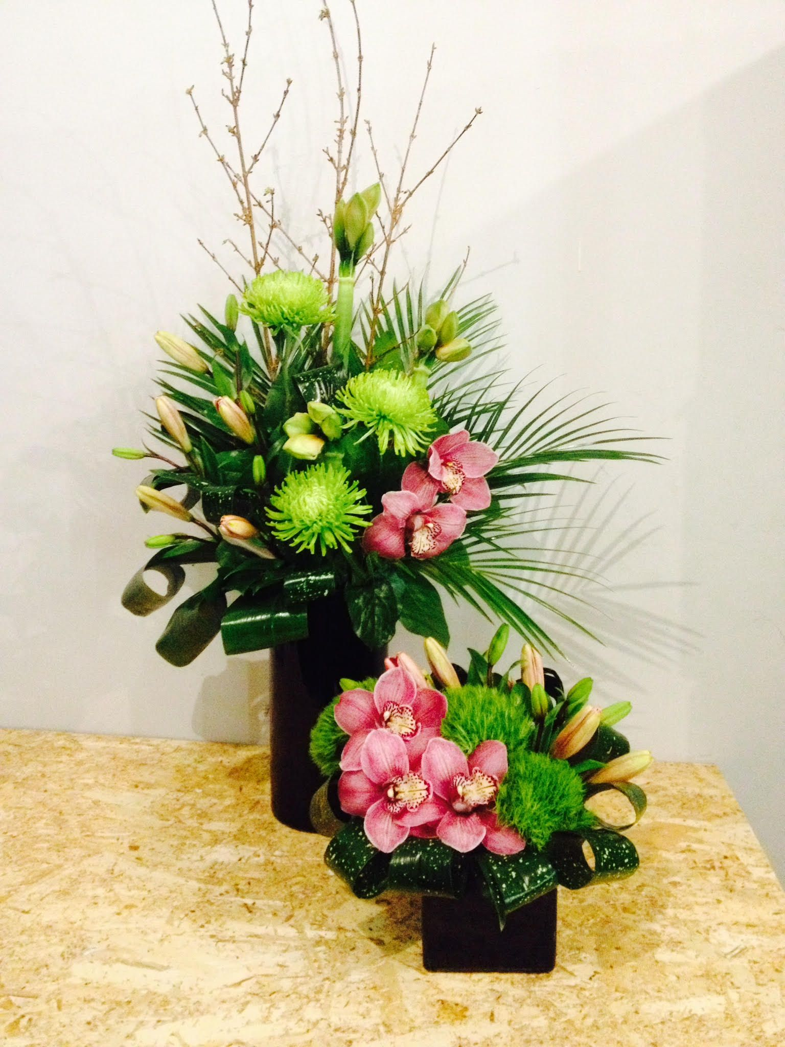 Beautiful Pink Orchids Lilies And Hydrangeas Perfectly Arranged In A Container With Ornamental Foliage And Acces Flower Delivery Flower Service Office Flowers