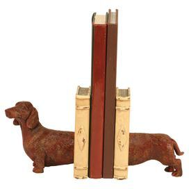 "Bookend with a dachshund silhouette.   Product: Set of 2 bookendsConstruction Material: ResinColor: BrownDimensions: 5"" H x 6"" W x 4"" D"