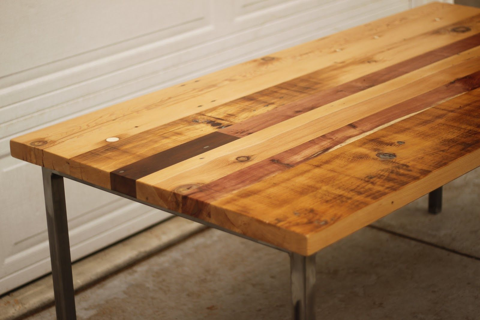 Simple Country Reclaimed Wood Table With Metal Base Legs As Rustic Dining  Table On Concrete Floor