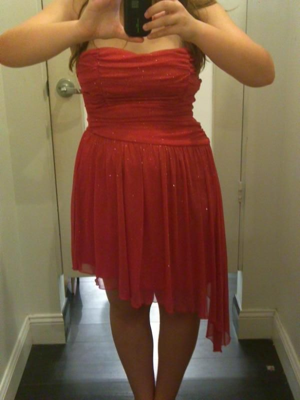 Just in case you all wanted to know, this is my homecoming dress. The lighting makes it look red but it's actually a dark coraly pink. :)