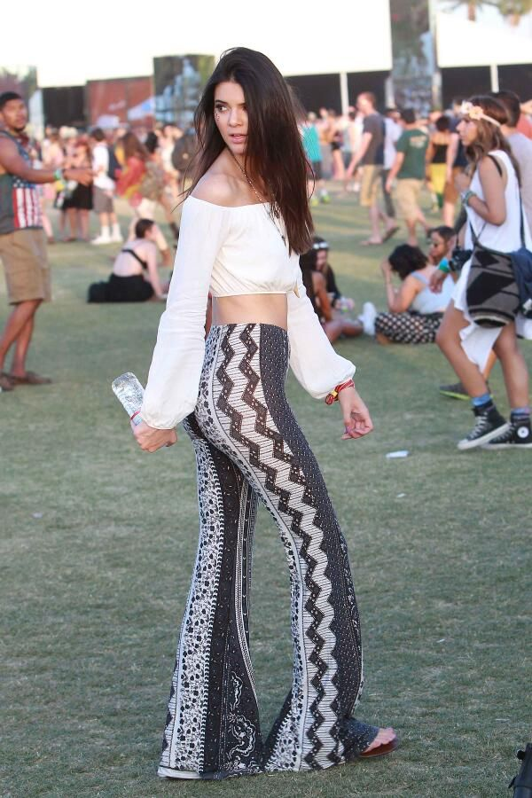 6a0937a92b6 Kendall Jenner dresses to perfection in high-rise hippie flare pants and a  cropped off the shoulder long sleeve flow shirt at Coachella