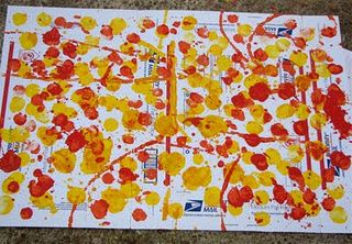 dip a ball in paint and bounce it onto paper to create splat art.... messy but fun:) - Big Art. A fave of mine!