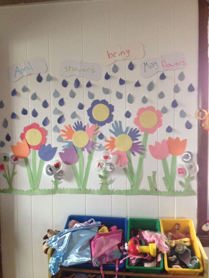 """April showers bring May flowers."" May bulletin board at the daycare."