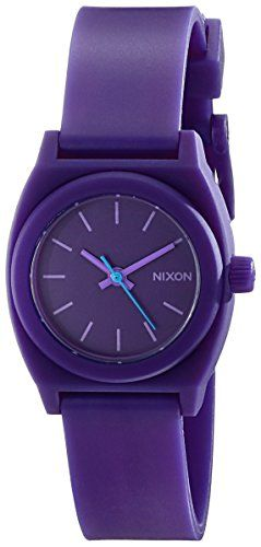 A scaled-down #Nixon watch, cast in bright matte rubber. Sleek markers detail the numberless dial, and a raised bezel accents the rounded case. Buckle clasp.