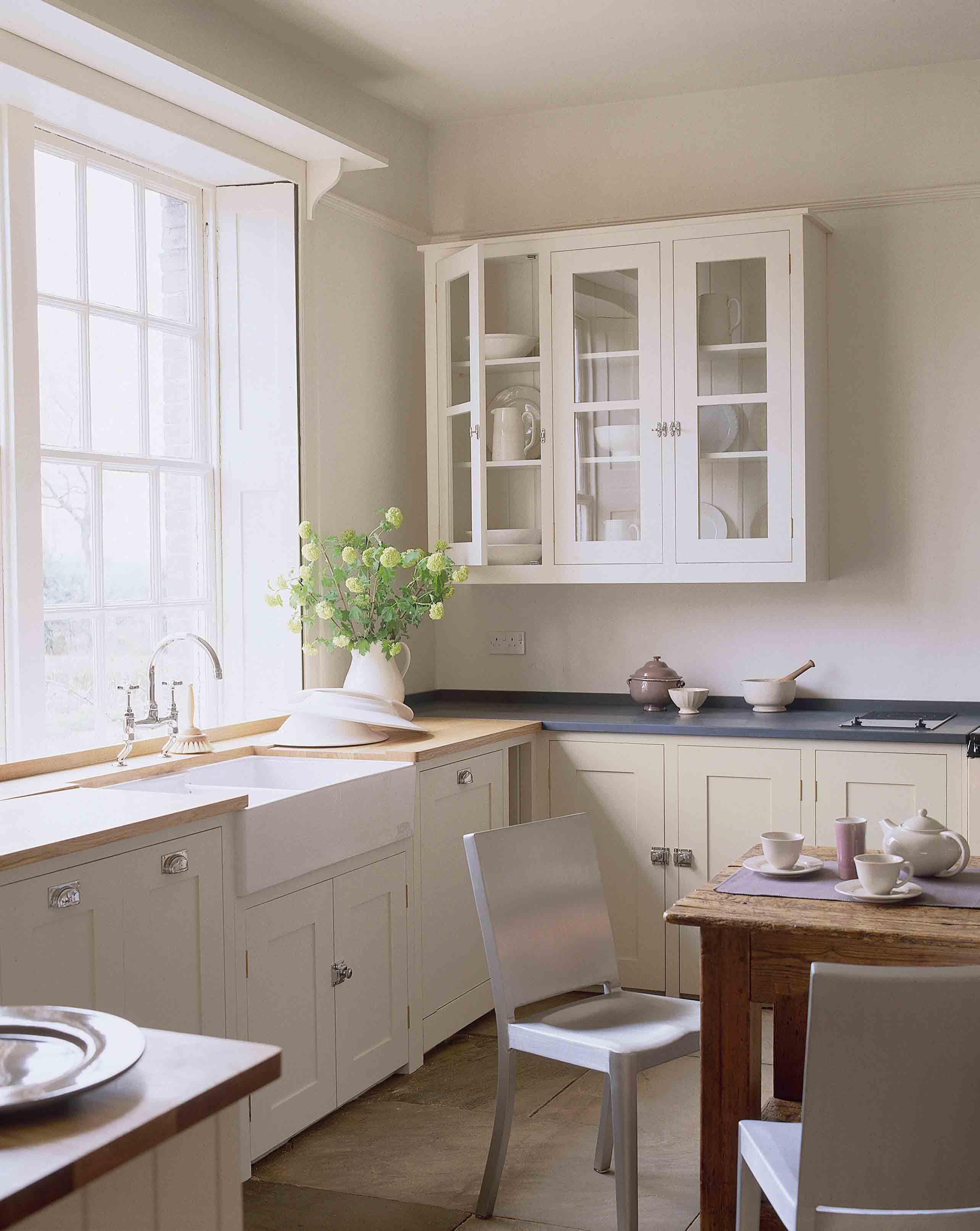 farmhouse kitchen designs uk. soapstone and white kitchen, big window, glass front upper cabinet farmhouse kitchen designs uk