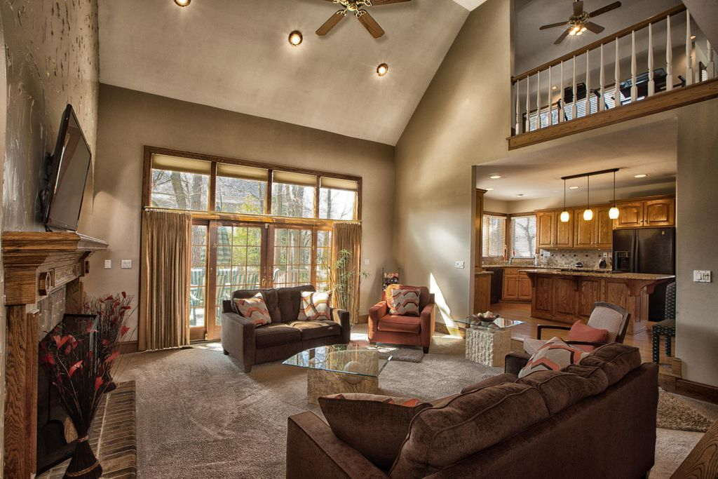 Traditional Great Room With Balcony Ceiling Fan Carpet Cathedral Ceiling Great Rooms Home Cathedral Ceiling