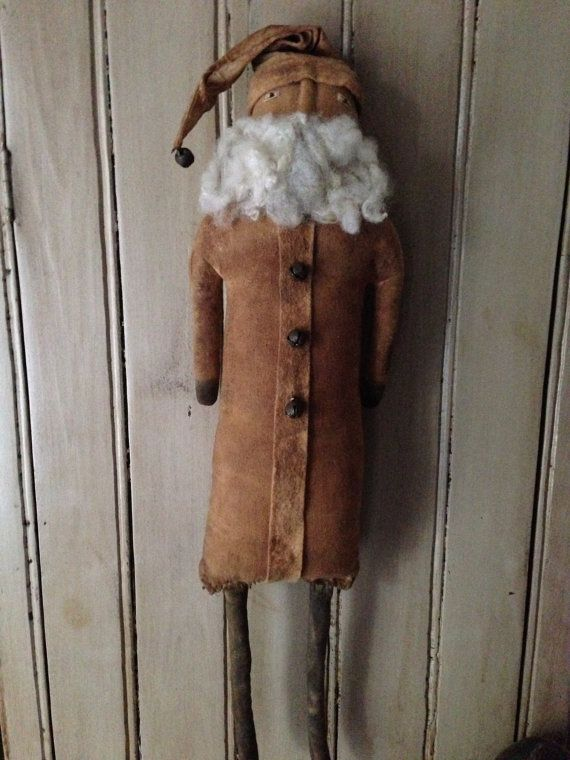 This santa is 24 tall and made of onasburg and has been painted and stained for a very worn look of yesteryear. Face is hand stitched and the beard is raw sheeps wool. He would make a great addition to your collection.