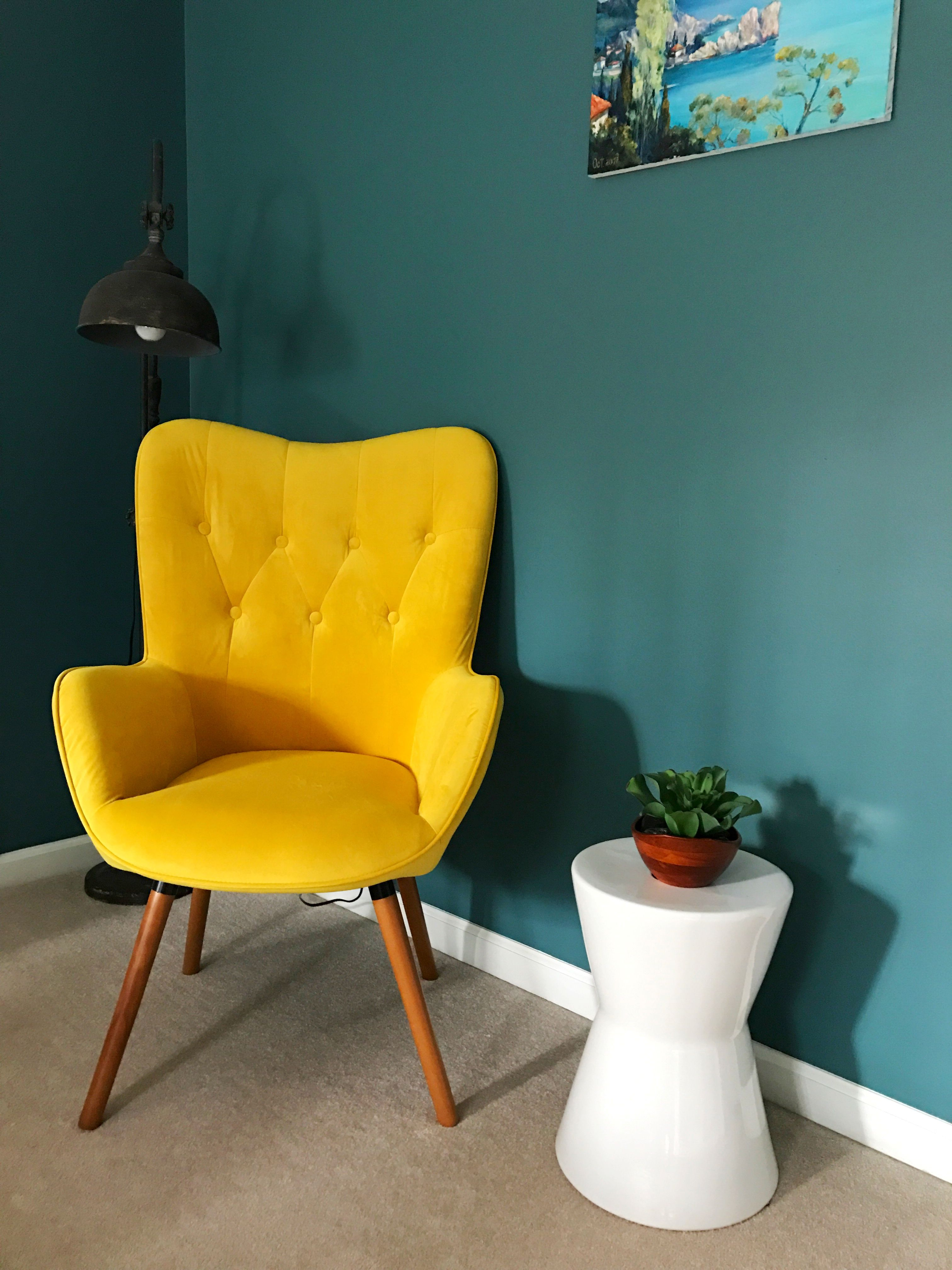 i used this yellow chair to add a small color splash into my moody ...