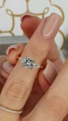 1.30 Carats Cushion Cut with 2 Pear Shape Side Sto