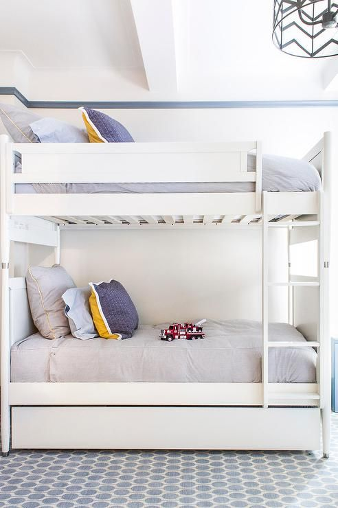 Contemporary Boys Bedroom Boasts A Modern White Bunk Bed Fitted With Trundle Dressed