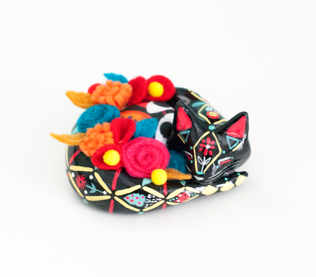 """""""Through her online shops, Emily Rose Thomson crafts tiny creatures you can hold in the palm of your hand. Sloths, camels, foxes, and more are hand-sculpted and adorned with repeating patterns and my favorite—tiny pillows and other colorful packs."""""""