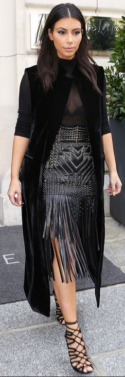 Kim Kardashian wears Hermes black lace up sandals and Roberto ...