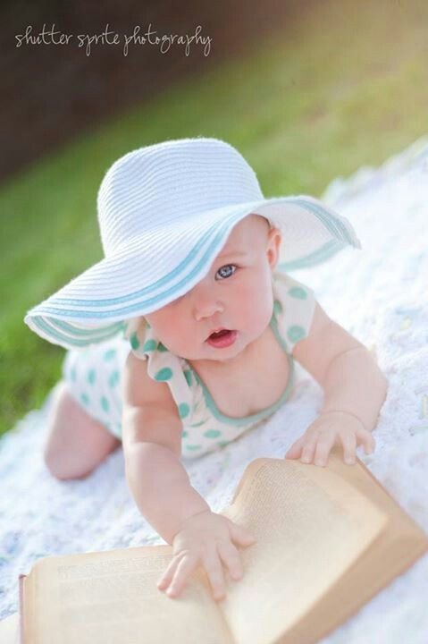 6 month photos - summer baby with books or have glasses on...