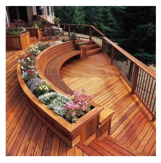 Wooden curved deck design built in planters bring bursts for Garden decking seating ideas