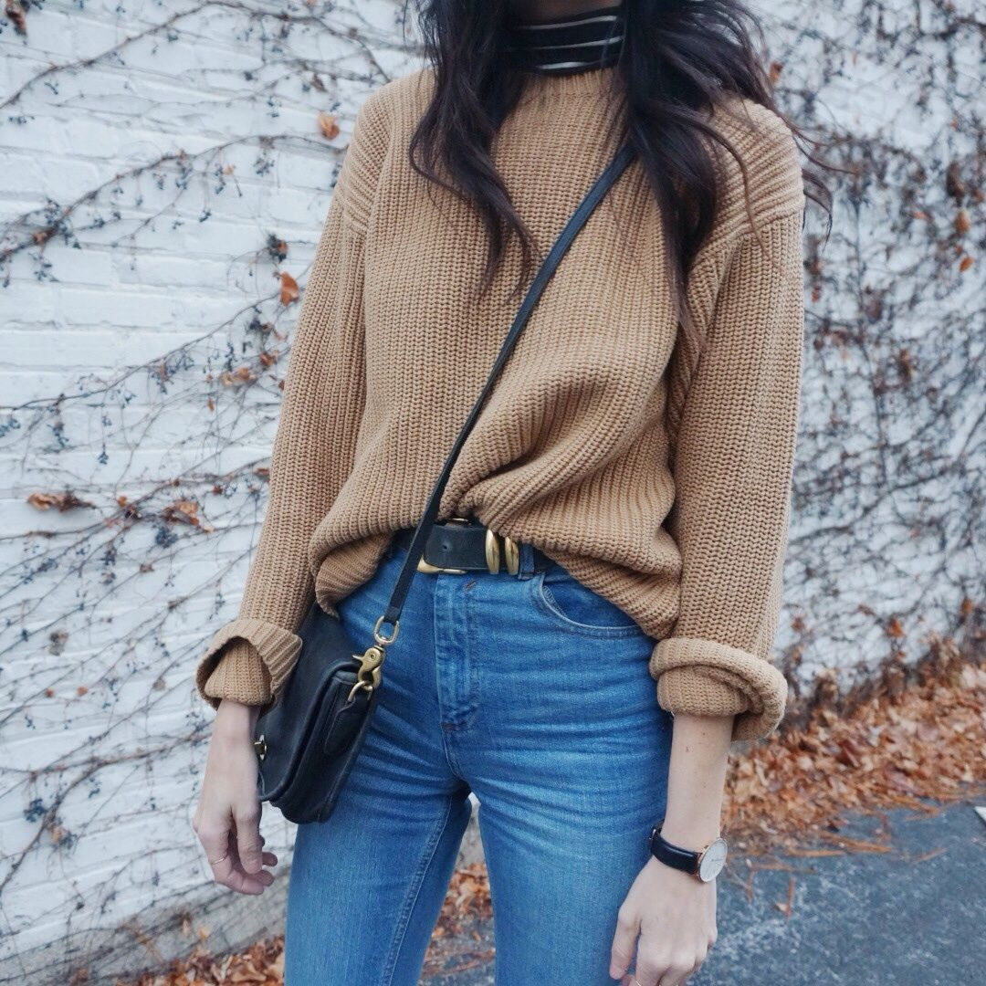 0834f127c66e03 Elongate your legs by slightly tucking in a sweater into high waisted  jeans—it s a simple fall look that makes a statement.