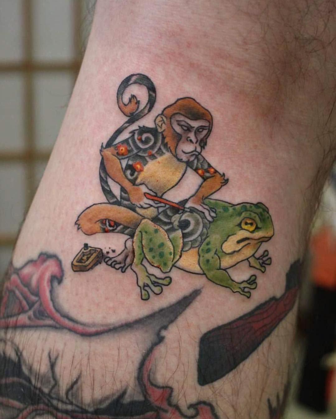 Monkey tattooing a frog — tattoo inspired by Horitomo's