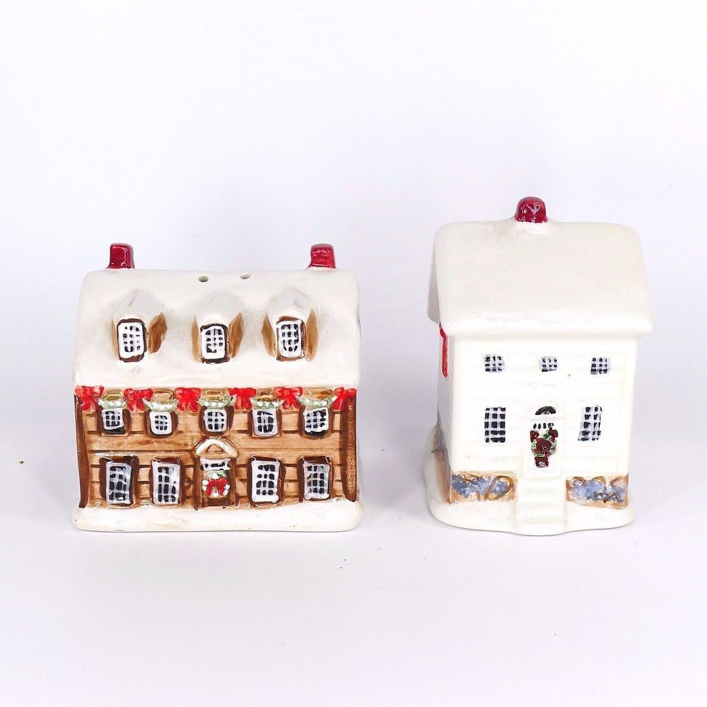 Pre-owned decorative collectible glazed ceramic novelty salt and pepper shaker set.  The set is designed to look like two houses or cottages with winter snow on the roof and are decorated for Christmas with garland and wreaths. #EverythingsCollectible #CollectItAll #SaltAndPepperShakers #Sakura