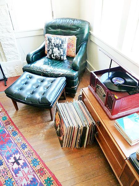 i need a great old leather chair and ottoman nestled next to my record player.